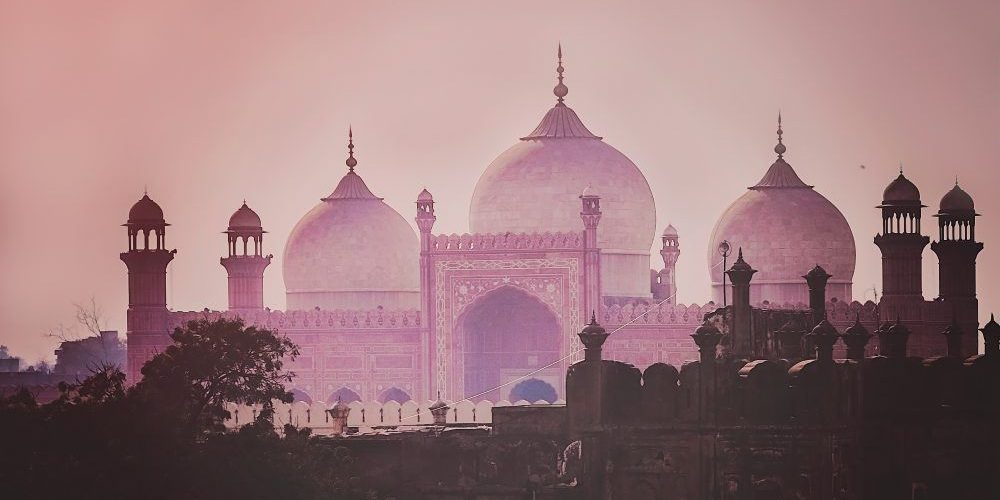 Domes of the The Badshahi Mosque (Emperor Mosque ) built in 1673 by the Mughal Emperor Aurangzeb in Lahore, Pakistan